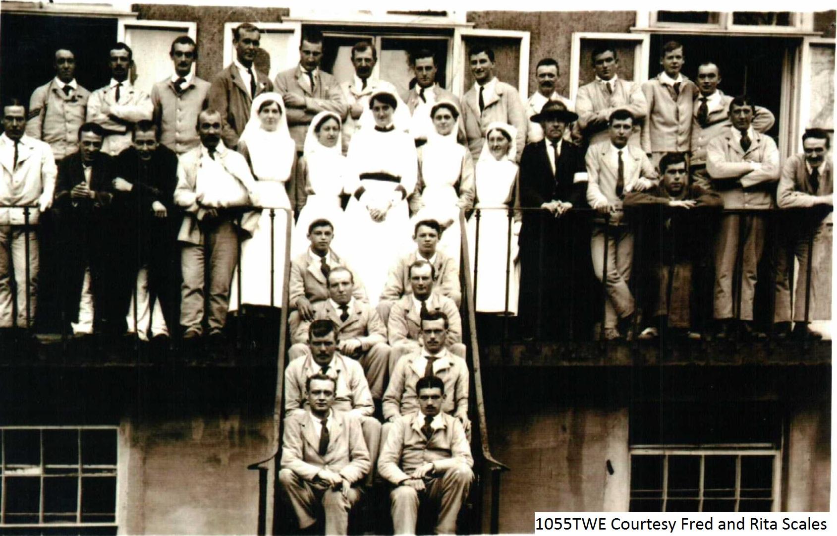 People on Hospital Balcony